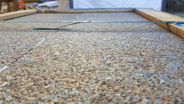 Close up of the brown granite coping stones