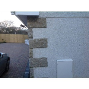 Brown granite corner stones used on wall