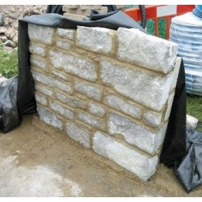 Limestone squared walling stone used in a mortared wall